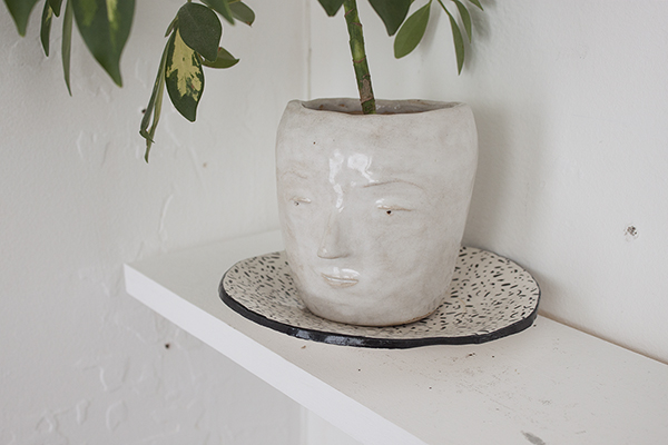 The Listener, 2013 Glazed ceramic and plant