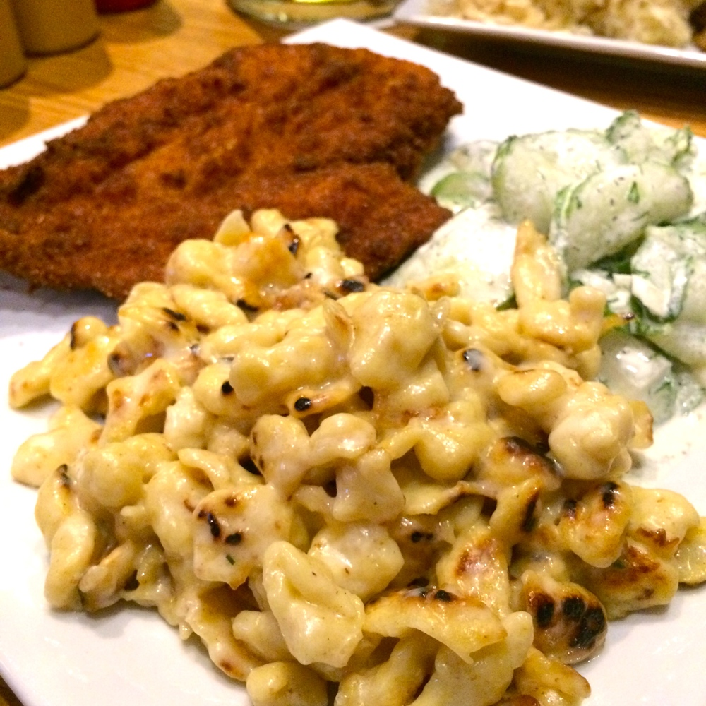 Chicken Schnitzel with a side of mac & cheese and cucumber salad - $15.00