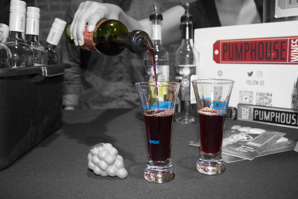 Pumphouse wine is poured into Oyster & Beer Festival signature glasses.