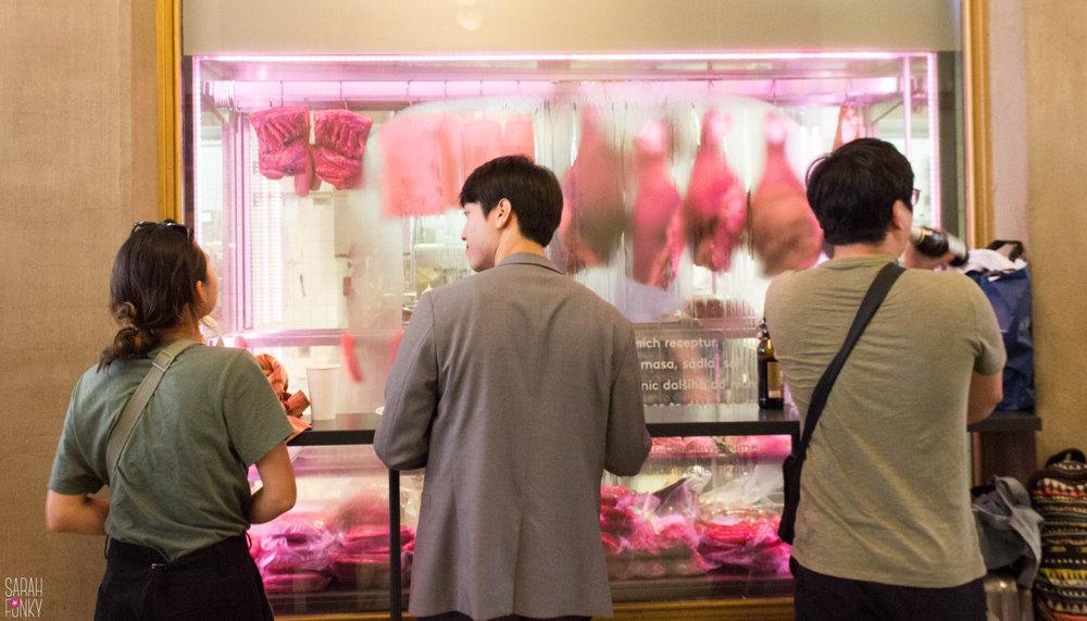 Hungry customers enjoy traditional Czech maso (meat)