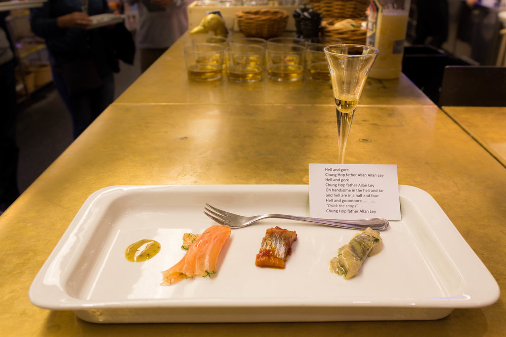 Salmon with mustard sauce, two different pickled herrings, and Linie liquor at Hav