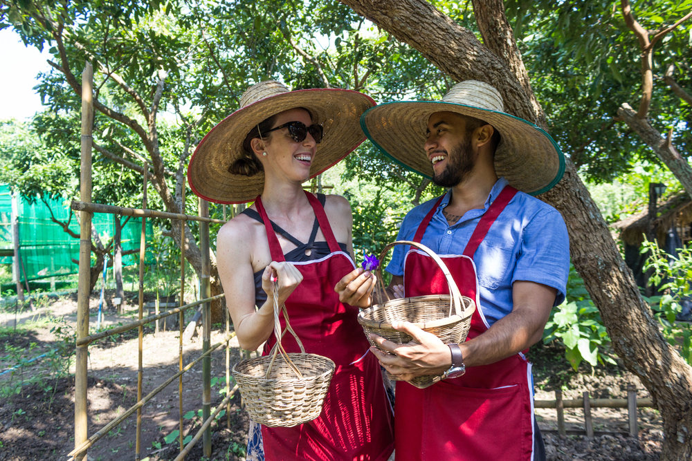Luis and I having fun picking fresh vegetables during our cooking class