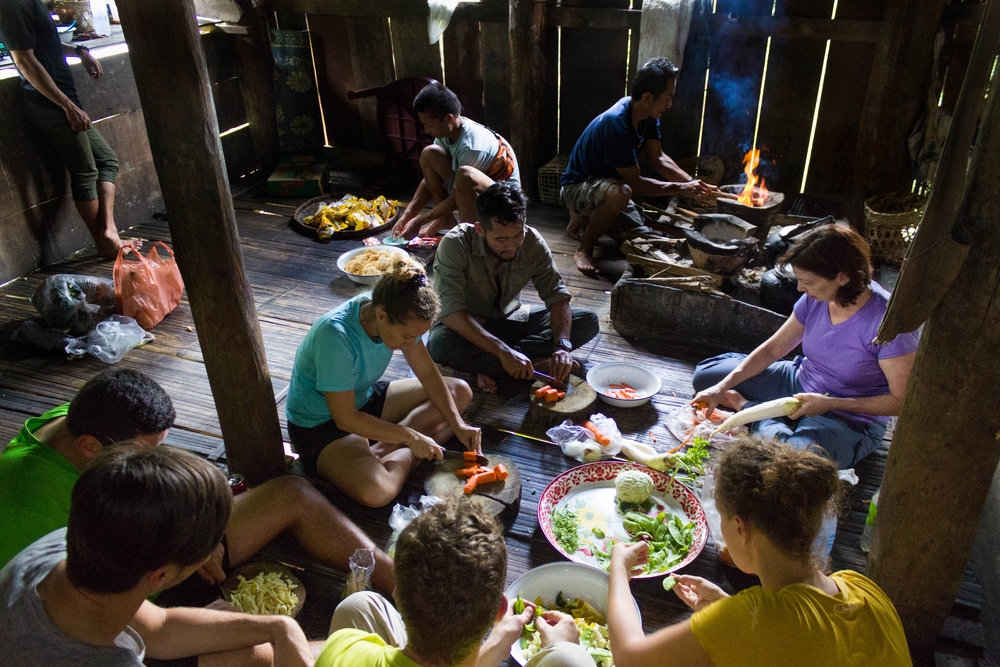Helping the local villagers prepare lunch