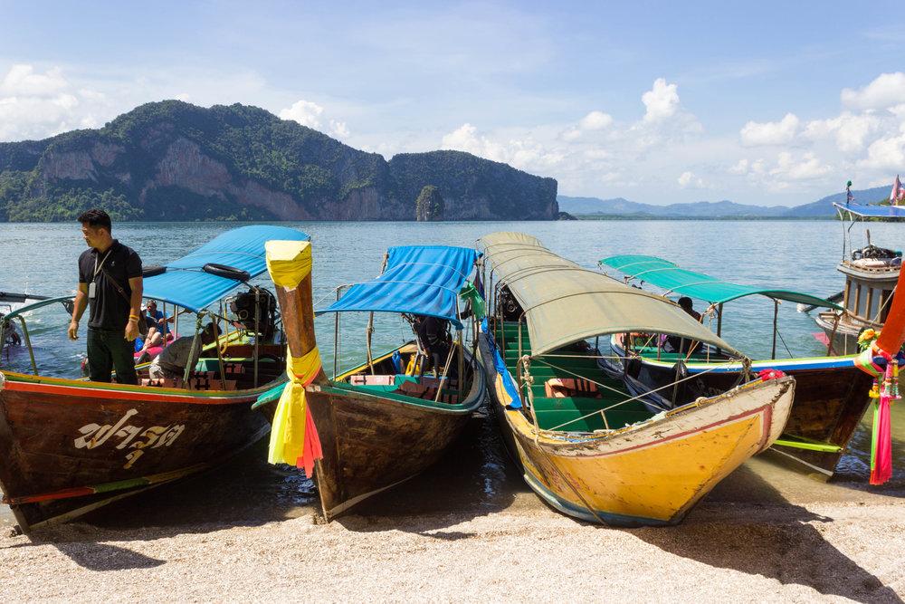 Colorful boats drop off guests at James Bond Island