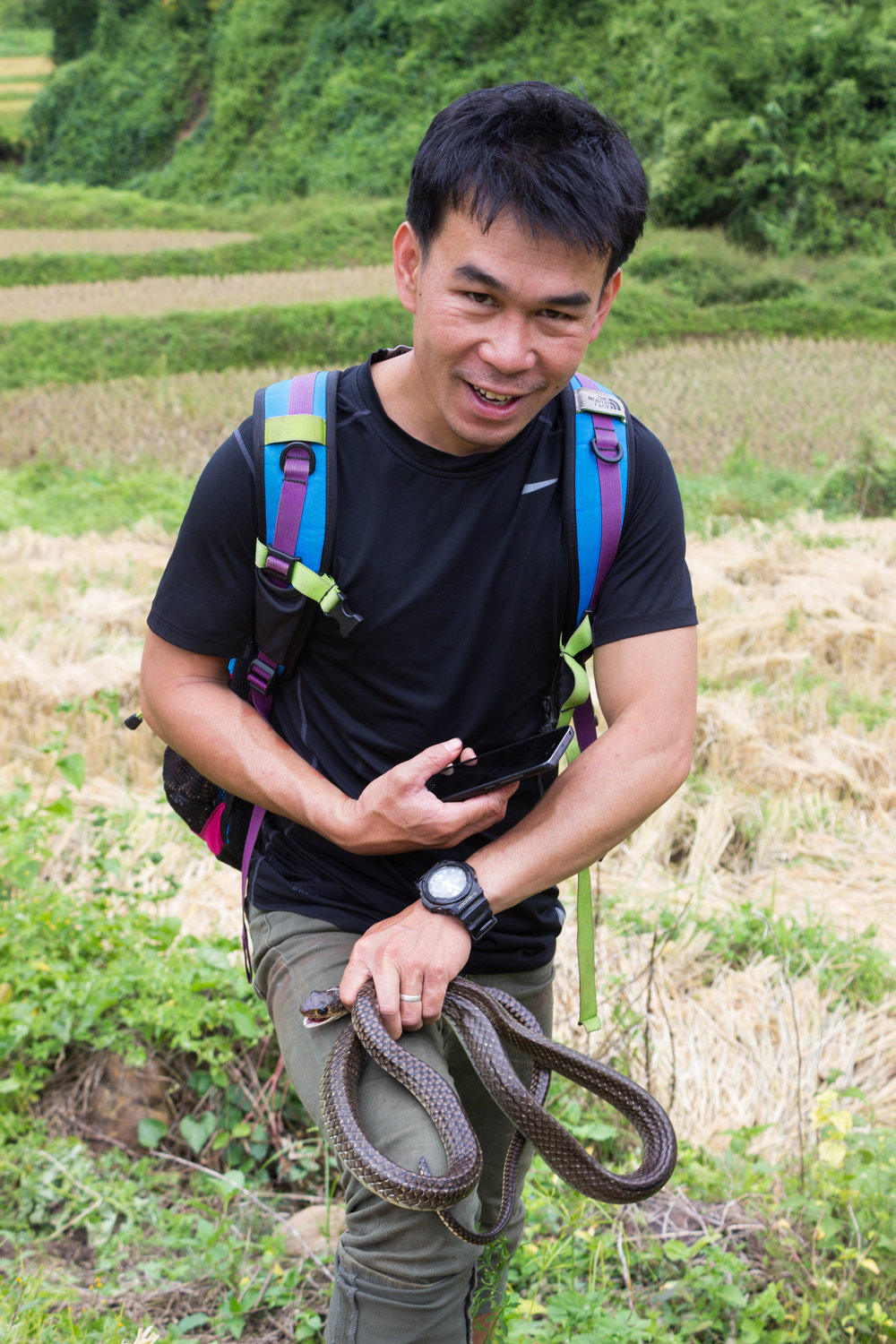Our guide holds the freshly caught snake (which was later made into soup!)