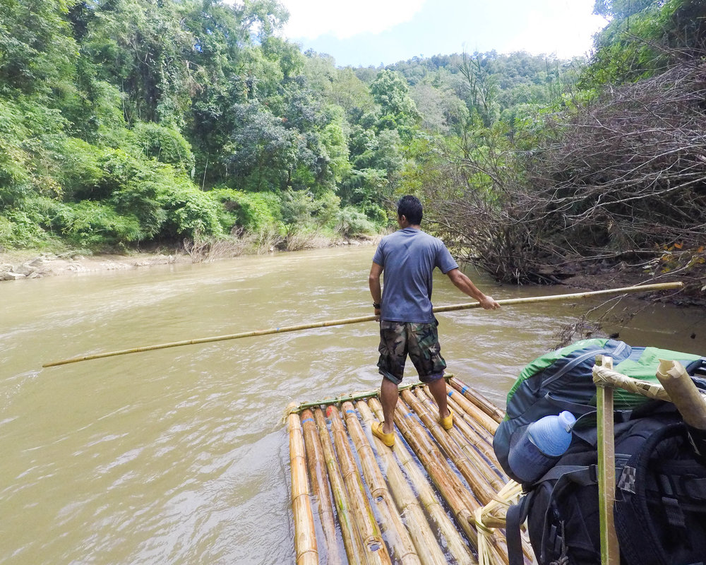 Our guide, Date, leads the bamboo raft