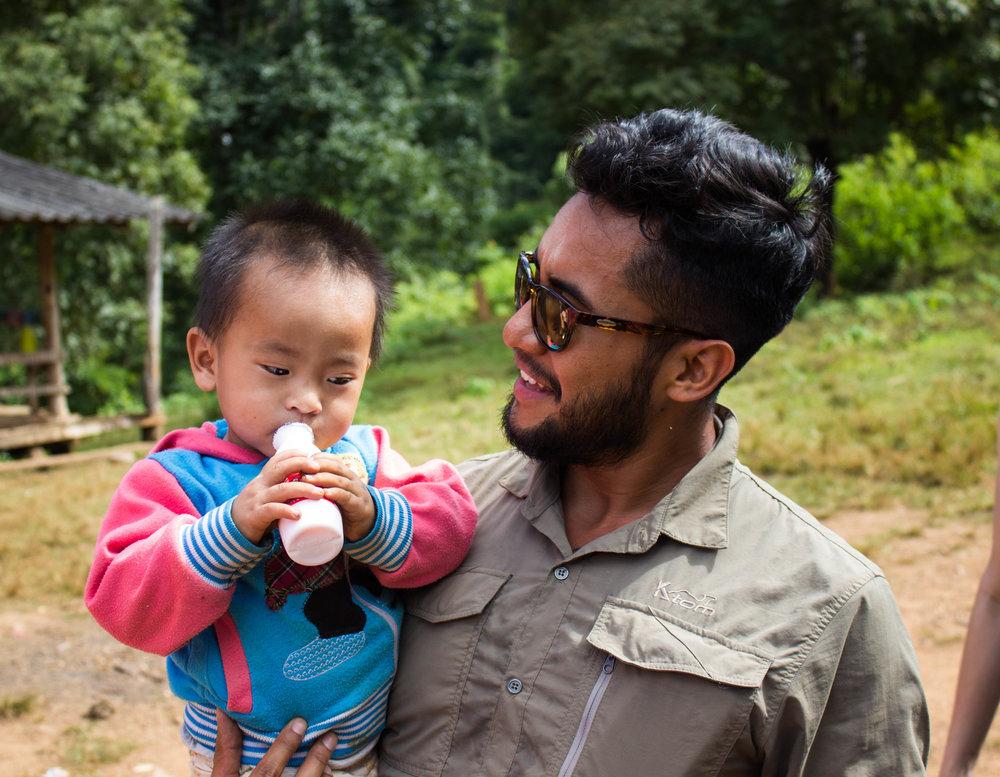 Luis plays with local village children