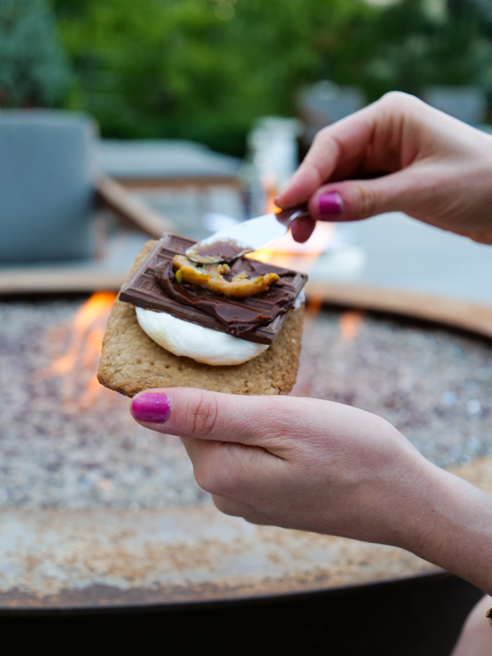 Putting the peanut and pistacio spread on the s'more