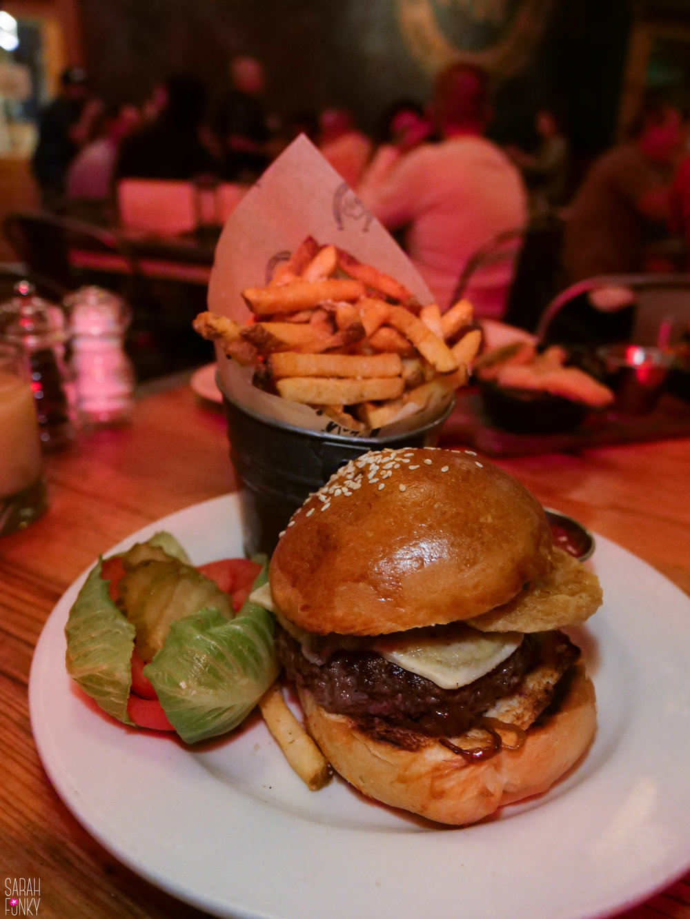 A burger at the Highwest Distillery and Salon