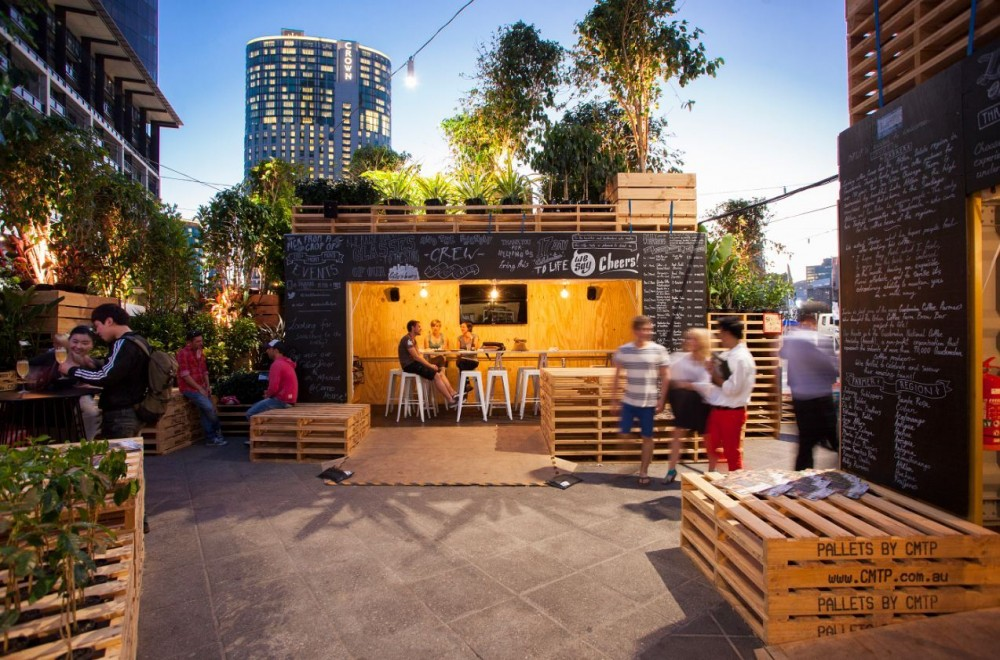 Urban Coffee Farm  by  Hassell  for the 2013  Melbourne Food & Wine Festival .  A project to show the community about the journey of coffee with an innovative reuse of shipping containers and pallets.