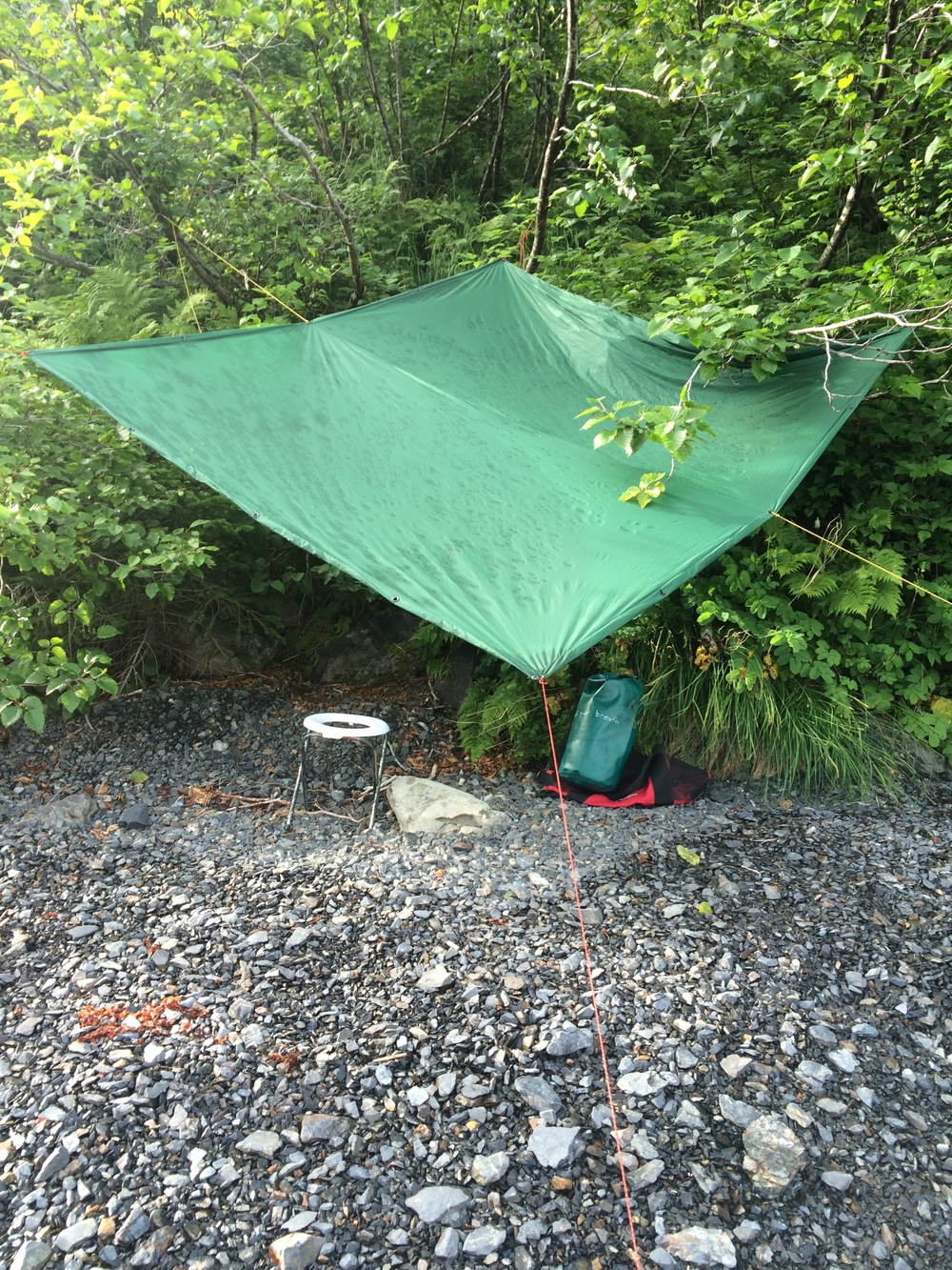 Bathroom set up in KFNP. Notice the dry spot under the tarp after a short rainfall. Quality tarpmanship.