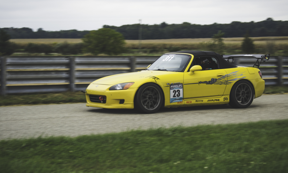 Twerk Team Racing 's yellow S2000 podium last season in HPDE+, Driven by Alex. This thing hauls and believe it or not its not even on Aftermarket coilovers! Look for this car to quietly put down some blazing times.