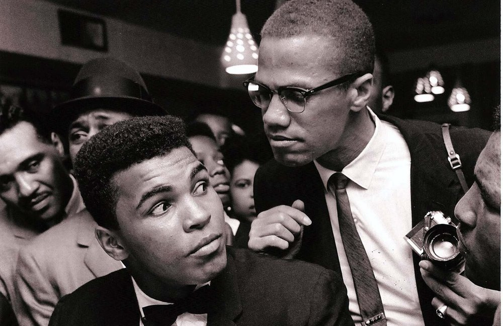 Muhammad Ali and Malcolm X in New York City, 1963. Photo by Bob Gomel.