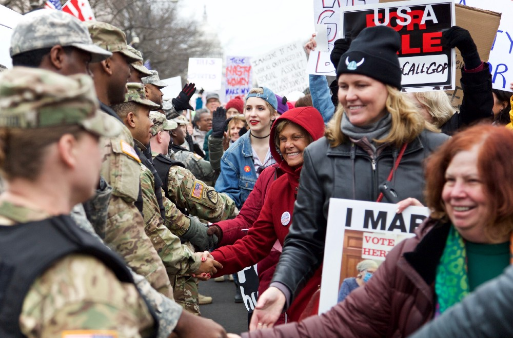 Participants in the Women's March in Washington D.C. forming a gratitude line to shake hands with members of the National Guard. Photo by author.