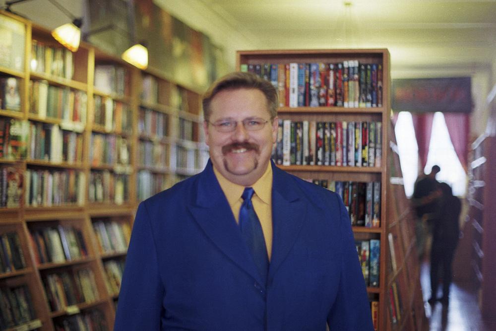 Jeremybedecked in his opulentblue suit at Borderlands Books.