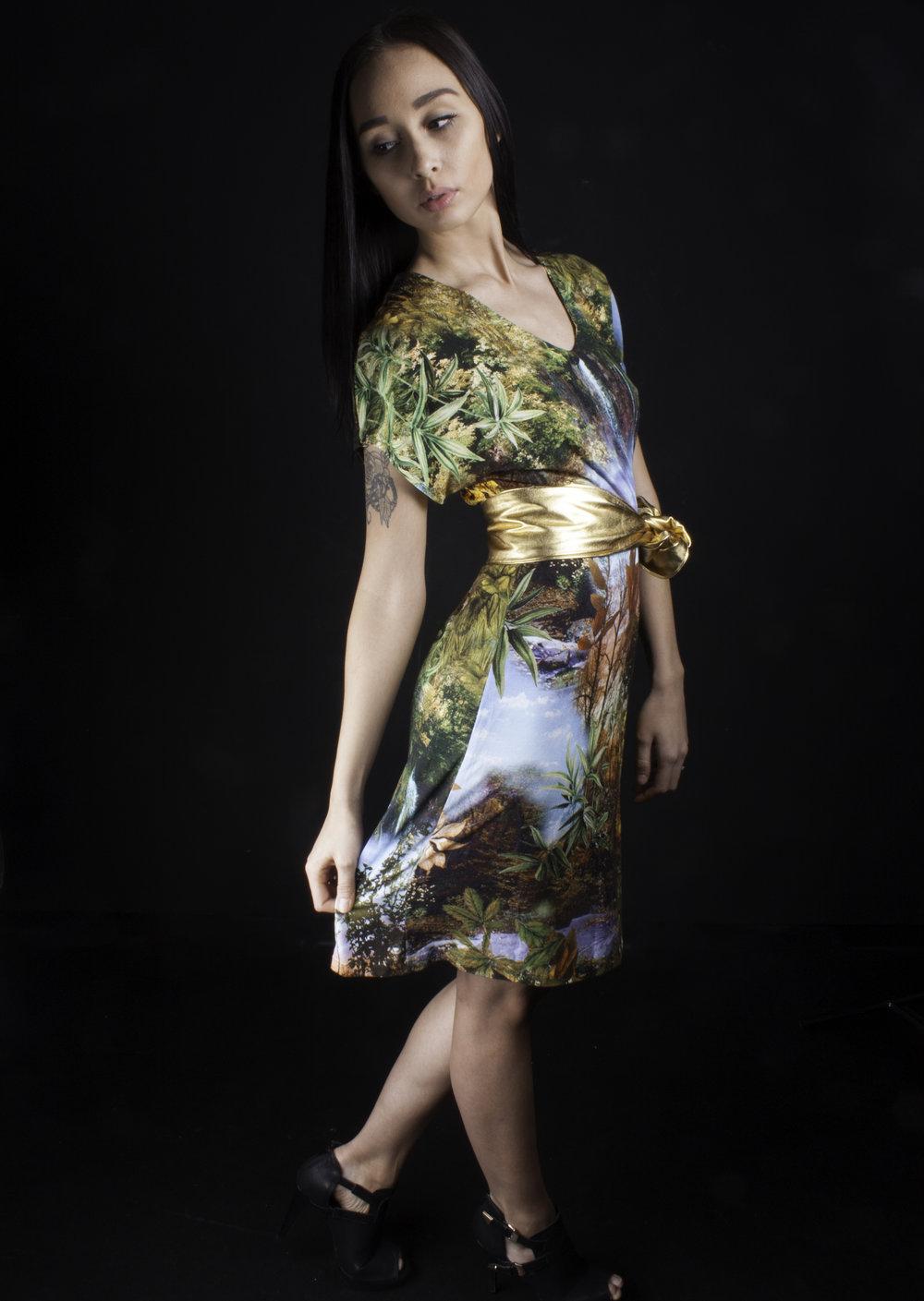 A line dress with a golden belt