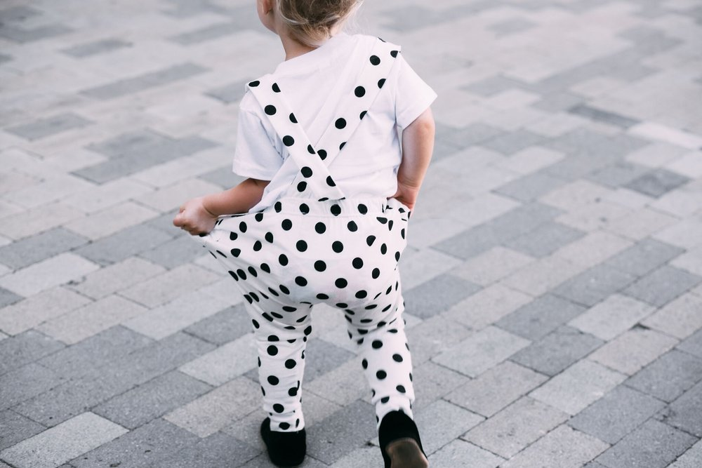 toddler baby girl street style wih polka dot suspenders and graphic tee