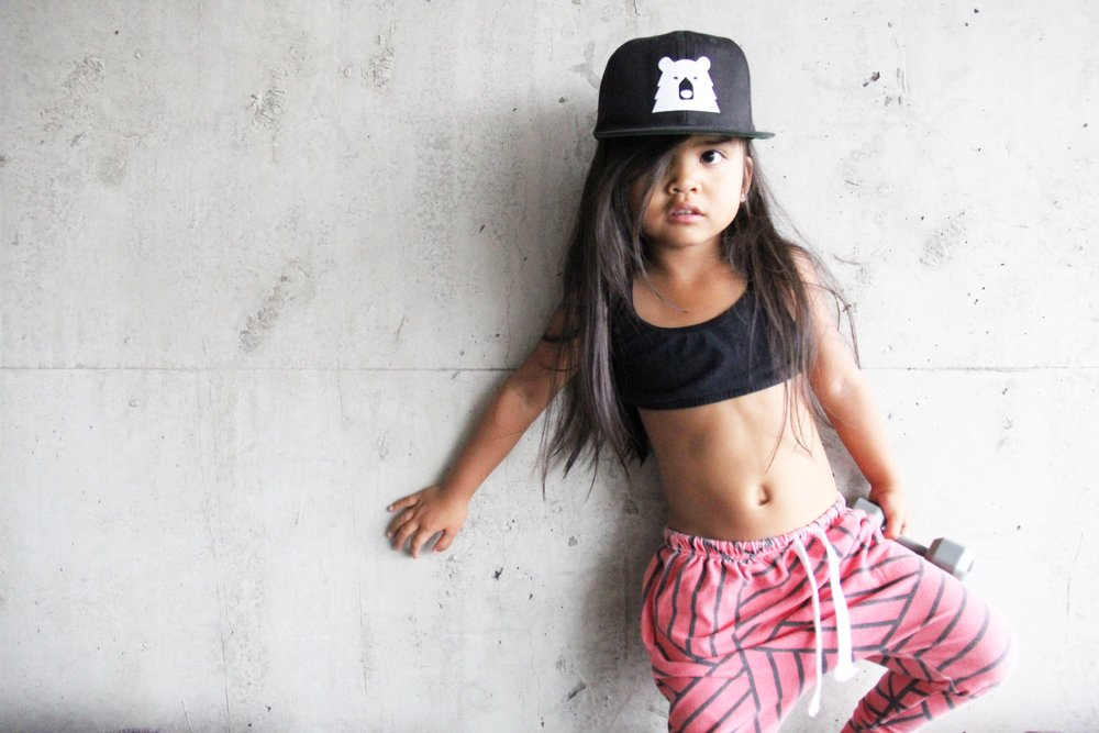 baby girl blood orange joggers black tank and snap back hat