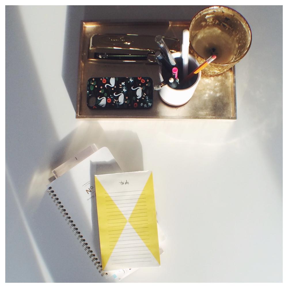 All the essentials - a to do list, calendar, candle and a gold stapler!