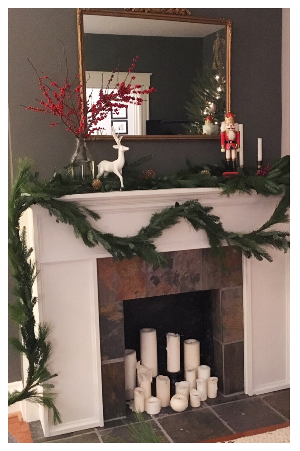 The finished mantel, with greenery and a touch of gold and red! I may even add a string of lights throughout the greenery. Too much?
