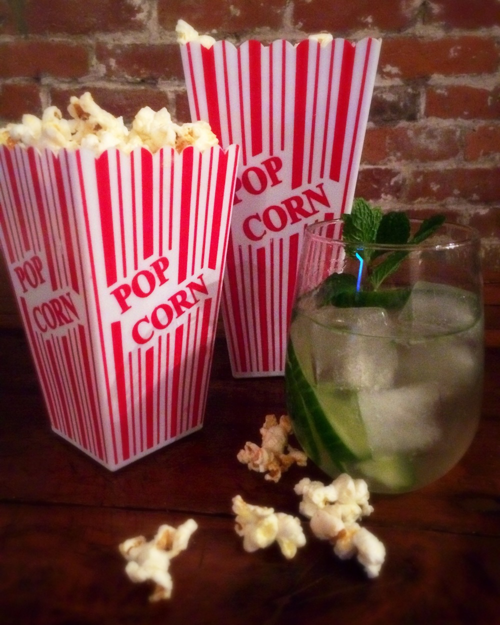 Sweet and spicy popcorn is perfectly complemented with a cool and refreshing Vodka Cucumber cocktail!