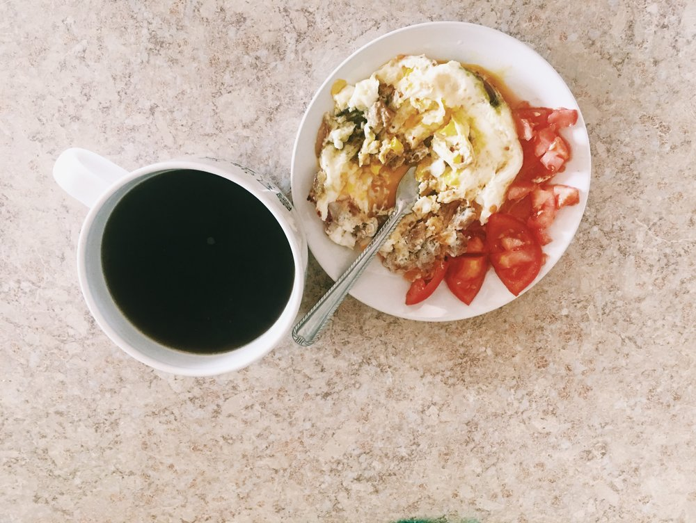 Black coffee brewed with cinnamon and nutmeg. Eggs with jalapeños and fresh tomatoes.