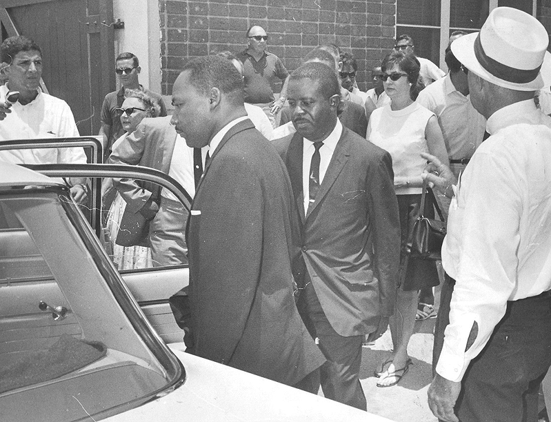 Dr. King and Ralph Abernathy are shown to the car by police chief Stuart during their arrest at the Monson.