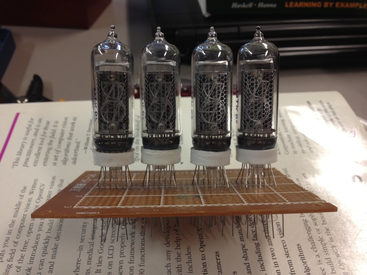 All four Nixie tubes & RGB LEDs soldered down.