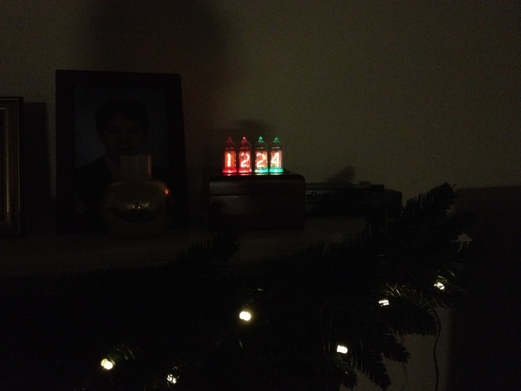 The clock can be set to alternate between the date & time. Here it is on the mantle on Christmas Eve.