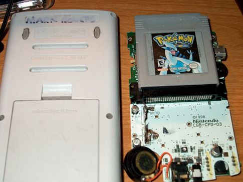 Reverse side of the TI-84 next to the GBC innards.