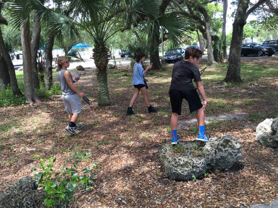 My not-so-little siblings shamelessly hunting Pokemon in the jungles of Miami.