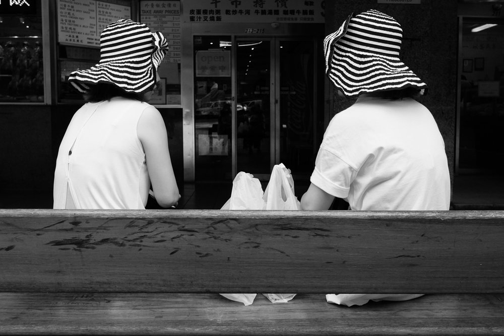 Street portrait of two sisters wearing a striped hat in Haymarket, Sydney| 28mm lens | 2018