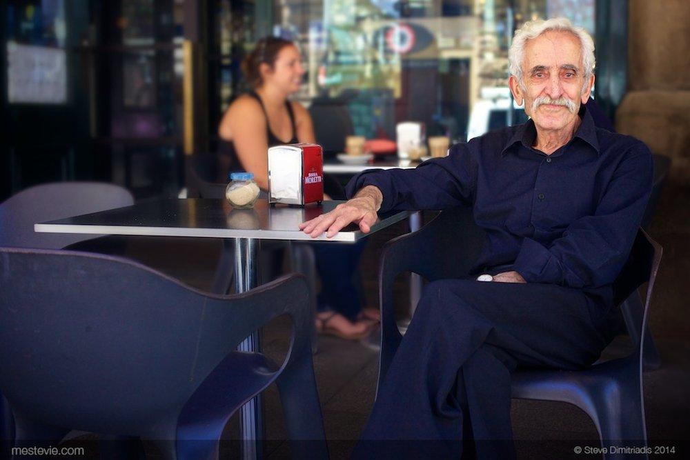 Street Portrait of a man sitting outside a restaurant in Sydney near Town Hall | 35mm lens | 2014