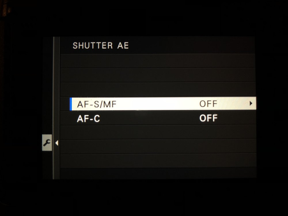 Shutter AE Off - Set Up>Button/Dial Setting>Shutter AE>AF-S/MF>Off