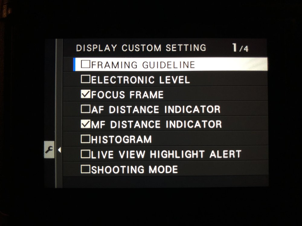 Select MF Distance Indicator - Set Up>Screen Set-Up>Disp. Custom Setting and check MF Distance indicator