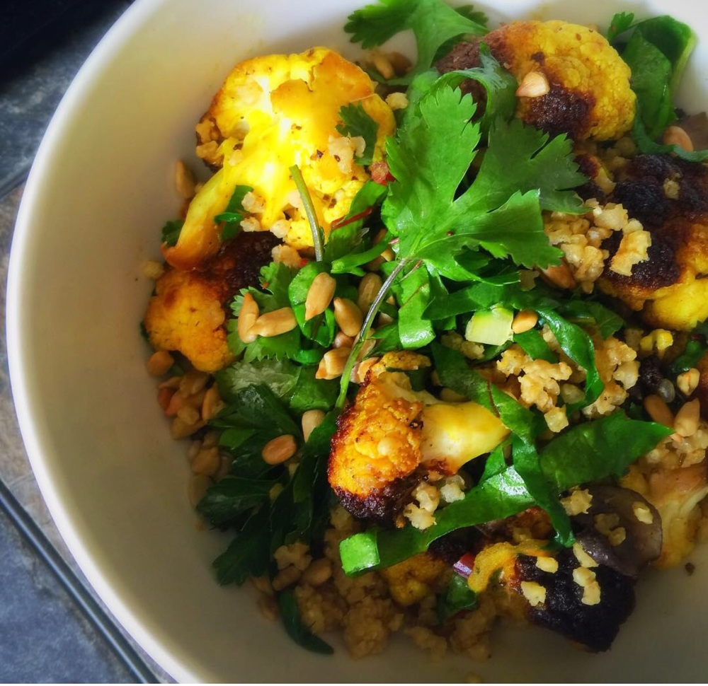 Turmeric Spiced Caulflower with Millet and Mushrooms. Topped with Sunglower Seeds, Rainbow Chard and Cilantro.