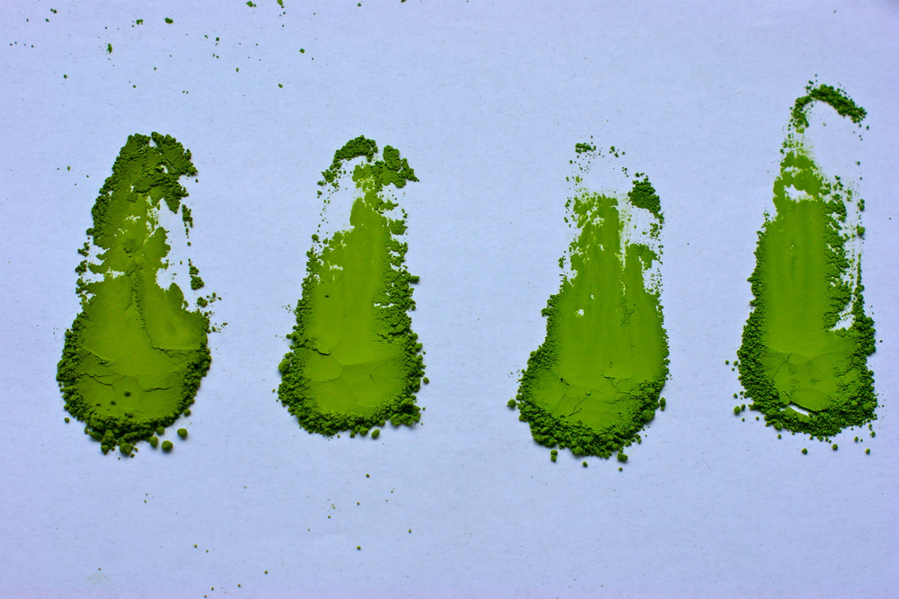 Samples of matcha - comparing them on white paper helps to understand color variations.