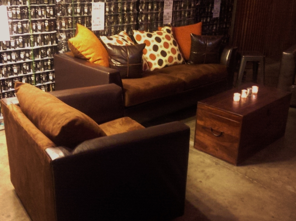 Clara Two Tone Sofas and swiveled Club Chairs. Pillows are reversible to reveal matching  brown in case orange is not your favorite.  The Numbers: 3 Couches, 6 Chairs, 6 Footstools, 3 Trunk Tables.