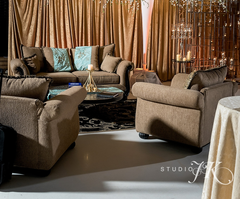 Chenille Taupe Sofas and Armchairs. Too ornate? The tapestry fringed pillows are reversible to reveal matching taupe chenille fabric.  The numbers: 3 Couches, 6 Chairs, 3 Trunk Tables. (Photo Courtesy of  Studio JK )