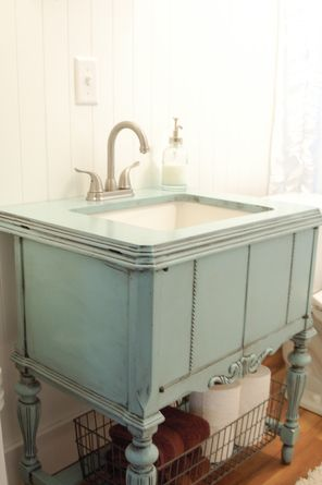I just loved this Vanity made from a Vintage Sewing cabinet from : This Old House via Pinterest.     Here is the before picture of the Sewing Cabinet that I purchased,