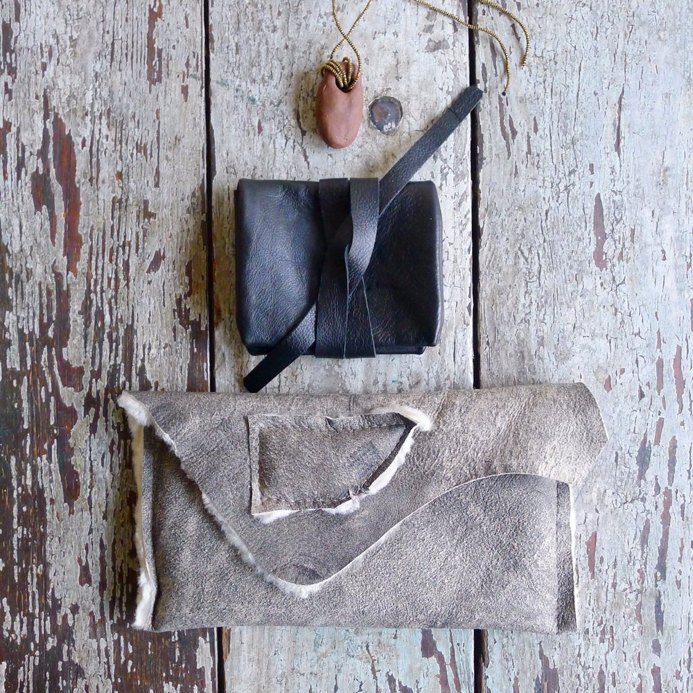 specialty dry goods leather wrap + nan collymore sheepskin clutch and ceramic necklace