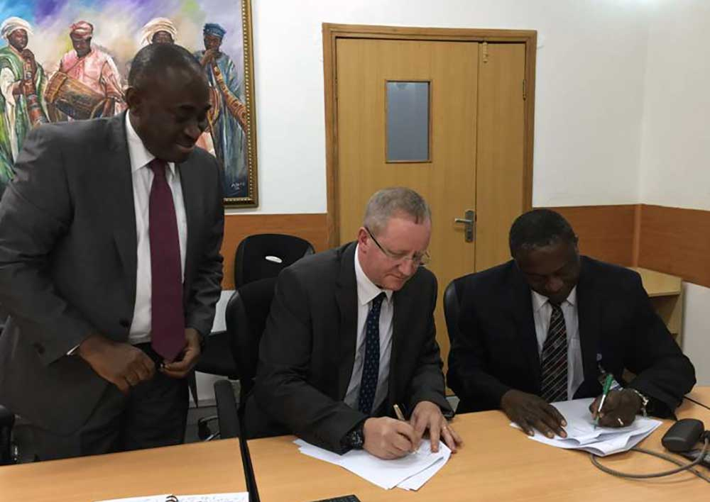Gede Foundation Managing Director, John Minto, and IHVN CEO, Dr. Patrick Dakum, signing a letter of agreement between the two organizations.