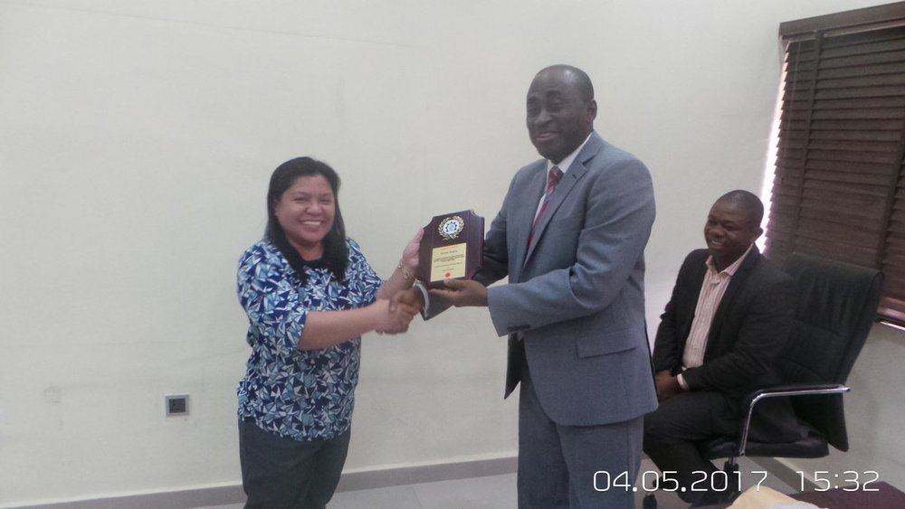 Ms. Jeremy Boglosa being presented with an award -