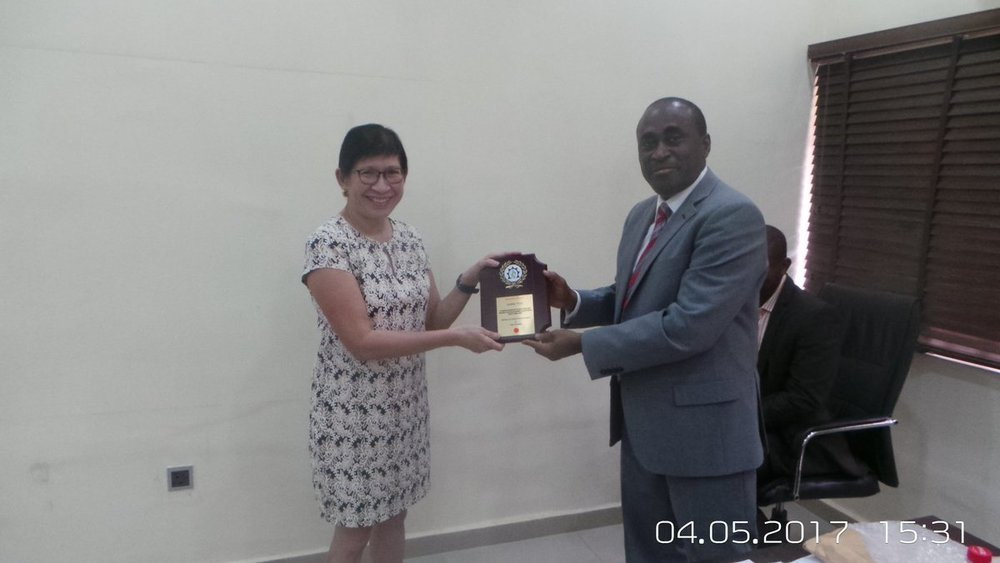 Dr. Ticao being presented with an award -