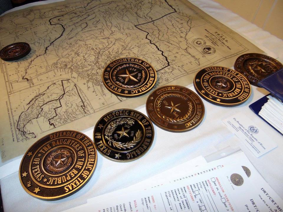 A bronze DRT medallion will be part of the 5-foot tall black granite Trammel's Trace marker.