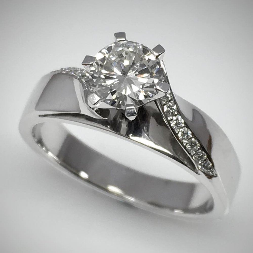 Handmade 18ct White Gold Diamond Engagement Ring set with a hidden secret Sapphire.