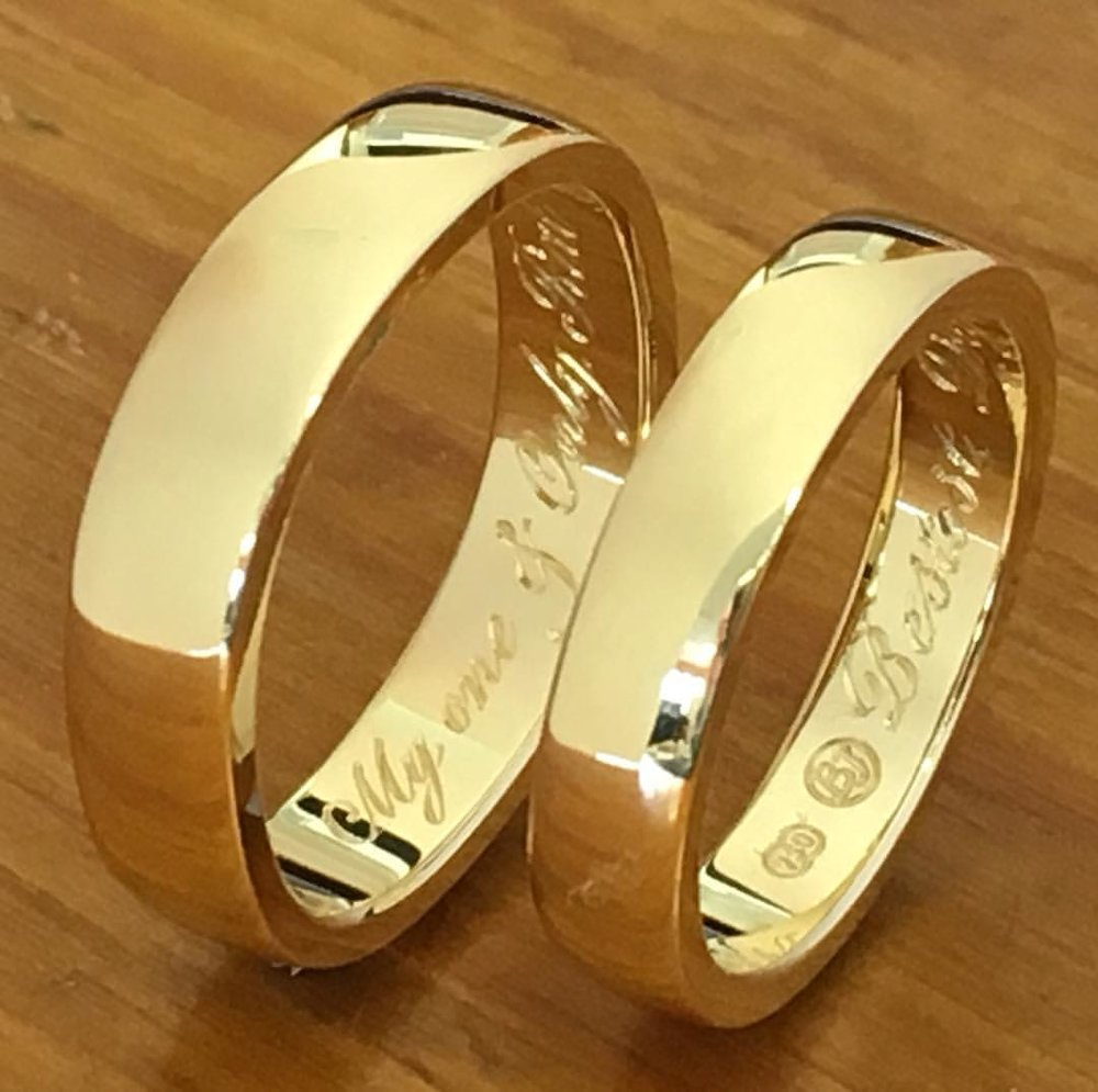 Handmade matching his and hers wedding rings with personal hand engraved scripts.