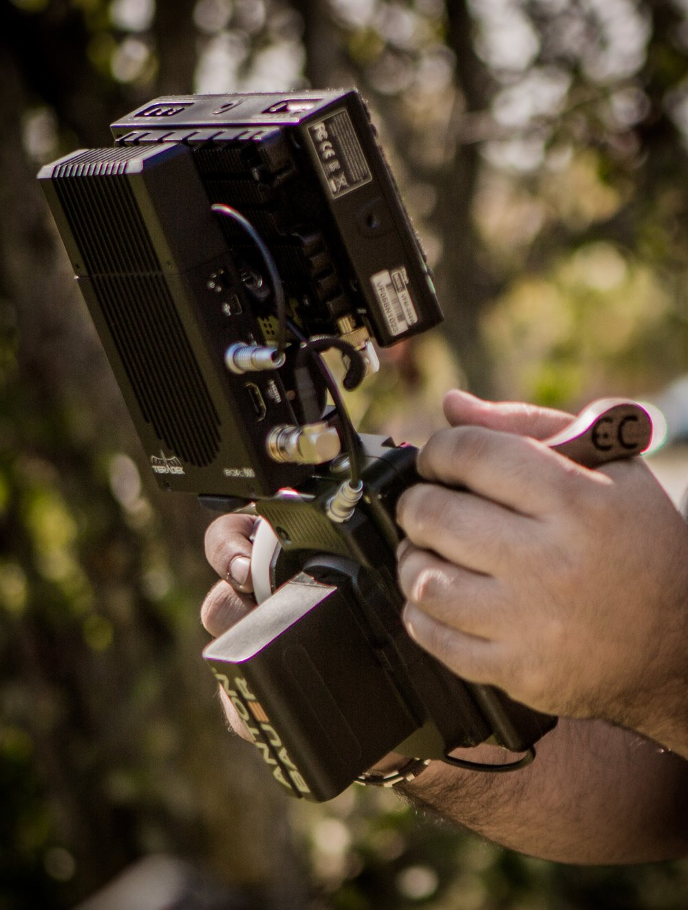 Not just a monitor bracket ... a fully portable solution with power distribution and for your monitor, receiver and the Teradek RT controller.  The side rosette grip is positioned on the same axis as the focus knob, making for a balanced and comfortable carry.