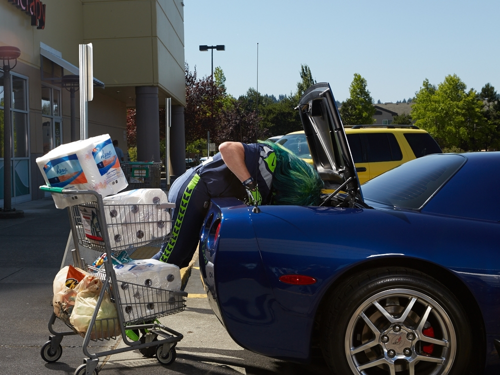 Mr. Seahawk loading paper towels into Mrs. Seahawk's blue Corvette, 2014