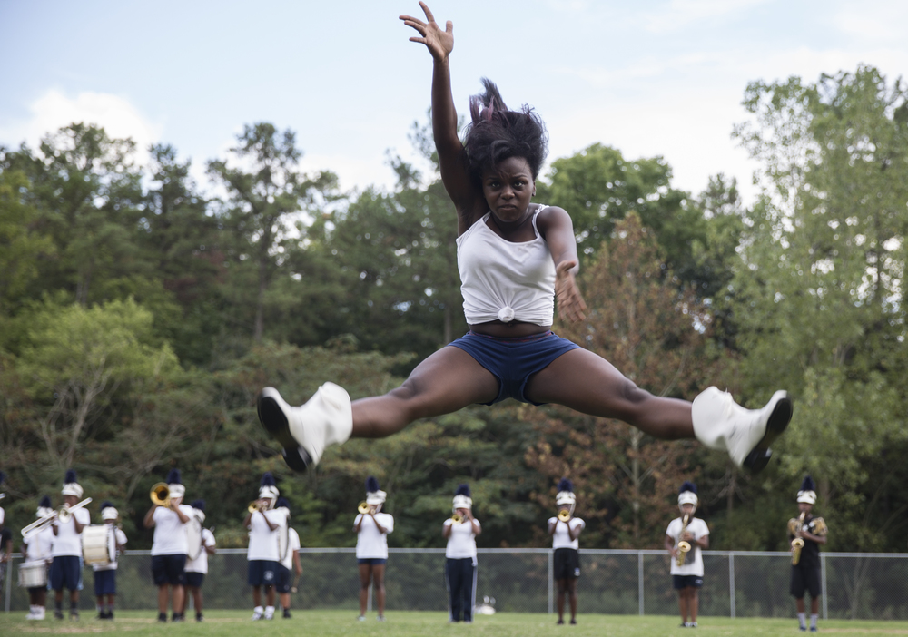During practice,   Kiana Sumpter, a sophomore,   begins to jump into a high split, her form pristine, as she moves along with the music.